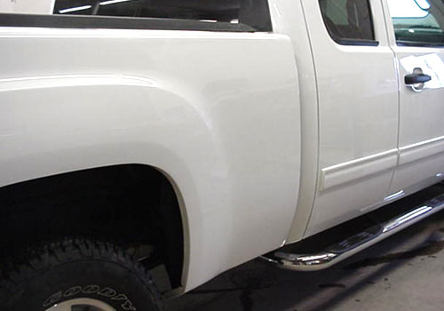 After photo of a white truck with repaired truck box damage performed by Wayne's Auto Body in Le Center, MN