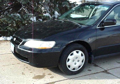After photo of a black car with repaired front-end collision damage performed by Wayne's Auto Body in Le Center, MN