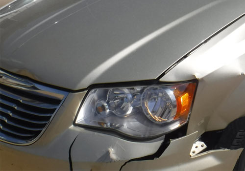 Before photo of a van with front-end bumper damage