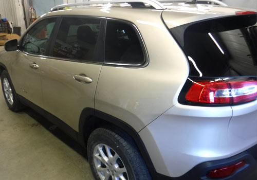 After photo of a silver SUV with repaired rear-end collision damage performed by Wayne's Auto Body in Le Center, MN
